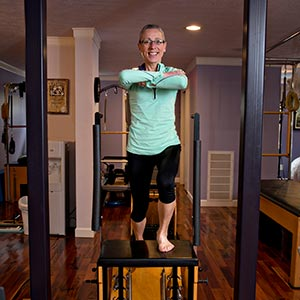 Marcia demonstrates a very challenging exercise on the Wunda Chair to strengthen legs while stabilizing the hips.